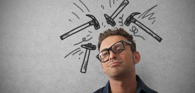 Man with glasses askew with line drawn hammers banging on his head